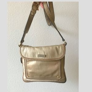 Cole Haan side-zip expand gold leather crossbody